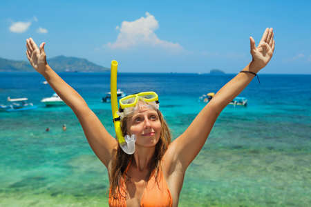 Happy family - active young woman in snorkeling mask. Sea lagoon beach scenic view, tropical island background. Travel adventure, swimming activity, watersports on summer holiday cruise with kids