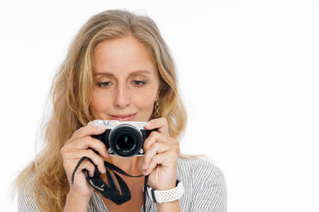 Positive friends portrait of happy young woman making photo. Lifestyle concept on white background.