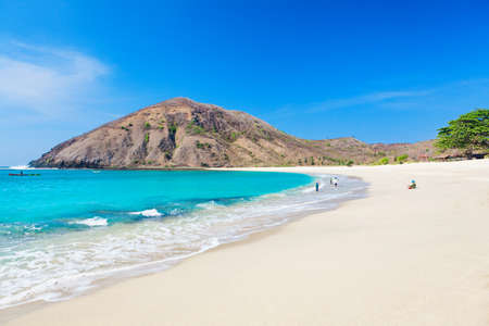 Beautiful view of turquoise water and white sand at tropical Mawun beach in Lombok, Indonesia