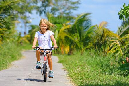 Young rider kid riding bicycle. Foto de archivo