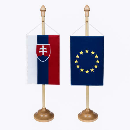 miniature: Slovak Republic and the EU flag in miniature and stand on a white background.