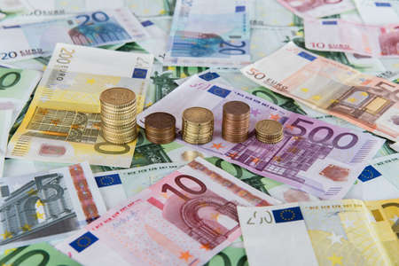 unpredictable: Euro banknotes and euro coins in simple example of unpredictable prognoses.