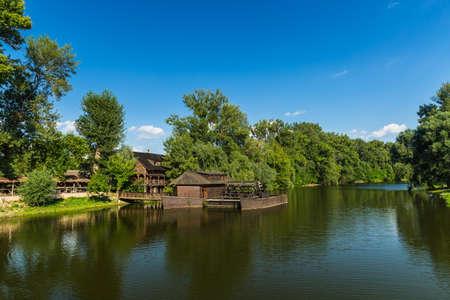 water mill: Water mill on boat in Slovakia city Kolarovo. Stock Photo