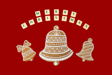 three wishes: Homemade three bells gingerbread and honey cookies on nice christmas theme with a wishes on red background.