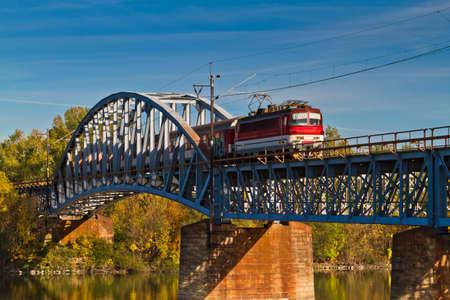 Train on the bridge . photo