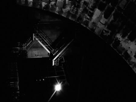 Illuminated stairs under the bridge