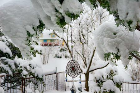 Frozen dream catcher after a snow storm Фото со стока