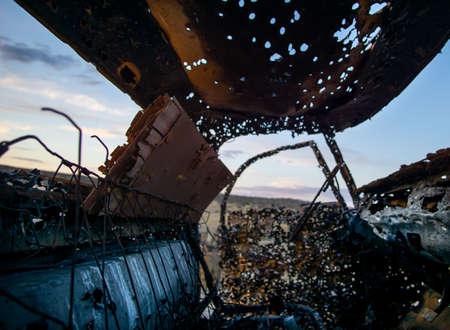 Abandoned vehicle in the desert full of holes 写真素材