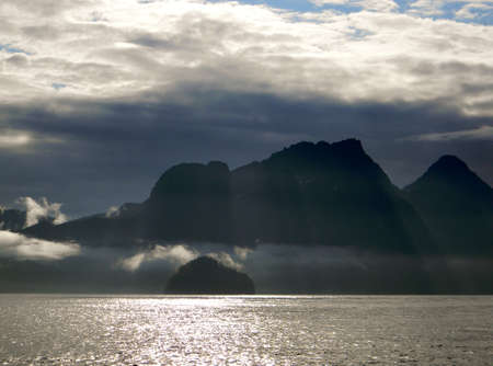 Sunrays over the mountains and ocean
