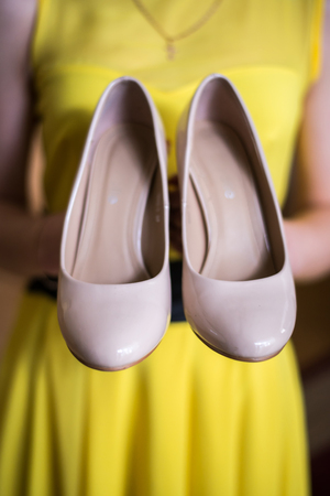 Wedding shoes on the gatherings of the bride