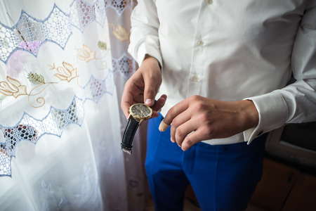 suit  cuff: businessman clock clothes, businessman checking time on his wristwatch. mens hand with a watch, watch on a mans hand, the fees of the groom, wedding preparation, preparation for work, mans style Stock Photo