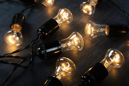 Light bulb lamp on blackboard background