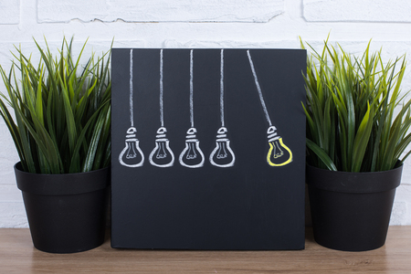 idea: Idea Light Bulb on Blackboard