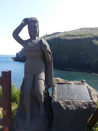A stone statue of female diver