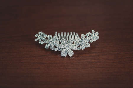 silver background: wedding jewelry, white earrings and bracelet bride, wedding ceremony, the brides morning, preparing for the wedding