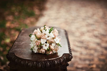 Beautiful bouquet of the bride in different color tones