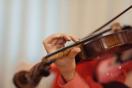 Girl playing the violin classical music, detail, Macro, studio lighting