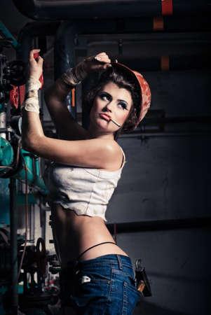 Girl wearing a helmet in the boiler room Stock Photo