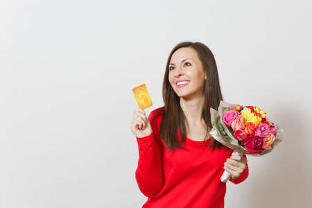 Young beautiful smiling woman holding bouquet of beautiful roses flowers credit card isolated on white background. Copy space for advertisement. St. Valentines Day or International Womens Day concept Stock Photo