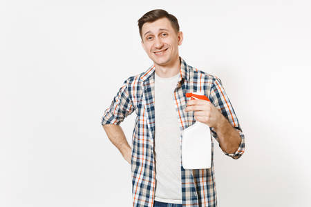 Young housekeeper man in checkered shirt holding white blank empty cleaning spray bottle with cleaner liquid isolated on white background. Male doing house chores. Copy space for advertisement