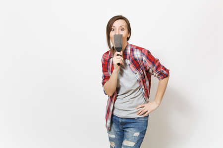 Young shocked beautiful woman in casual clothes covering face with putty knife isolated on white background. Instruments, accessories, tools for renovation apartment room. Repair home concept Stok Fotoğraf