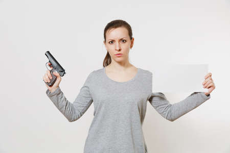 Woman holding gun, blank empty sheet card, copy space isolated on white background. Archivio Fotografico