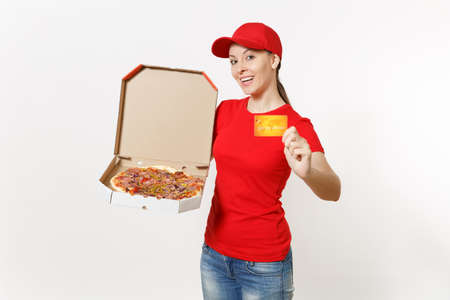 Delivery woman in red uniform isolated on white background. Female in cap, t-shirt, jeans working as courier holding italian pizza in cardboard flatbox and credit card. Copy space for advertisement