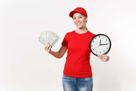 Delivery woman in red uniform isolated on white background. Smiling female in cap, t-shirt, jeans working as courier or dealer, holding bundle odollars cash money clock. Copy space for advertisement