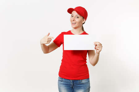 Delivery woman in red uniform isolated on white background. Female courier in cap, t-shirt, jeans holding white empty blank paper. Copy space advertisement. Place for text or image. Advertising area