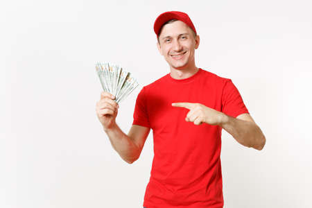 Delivery man in red uniform isolated on white background. Professional male in cap, t-shirt working as courier or dealer, holding bundle of dollars, cash money. Copy space for advertisement Stok Fotoğraf