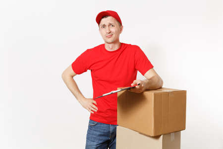 Delivery man in red uniform isolated on white background. Male courier in cap, t-shirt holding pen, clipboard with papers document, blank empty sheet, cardboard box. Receiving package. Copy space