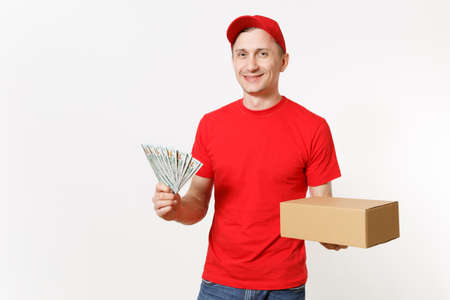 Delivery young man in red uniform isolated on white background. Male courier in cap, t-shirt holding bundle of dollars, cash money, empty cardboard box. Receiving package. Copy space advertisement