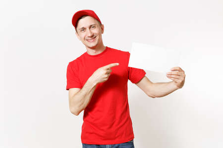 Delivery man in red uniform isolated on white background. Male fun courier in cap, t-shirt, jeans holding white empty blank paper. Copy space advertisement. Place for text or image. Advertising area