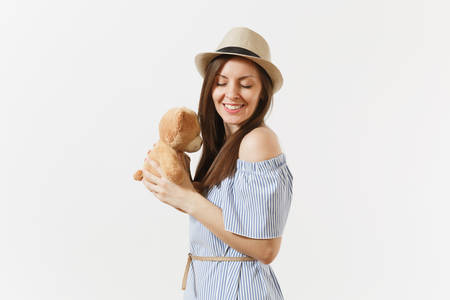 Young tender elegant charming woman dressed blue dress, cute hat with long brunette hair posing isolated on white background. People, sincere emotions, lifestyle concept. Advertising area. Copy space