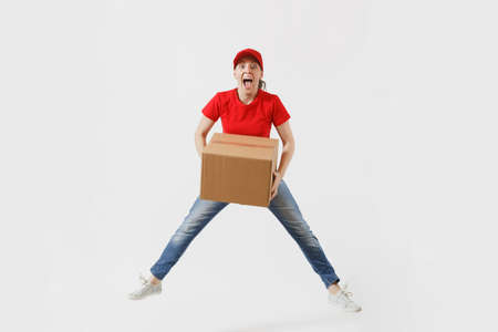 Full length portrait of fun delivery woman in red cap, t-shirt isolated on white background.