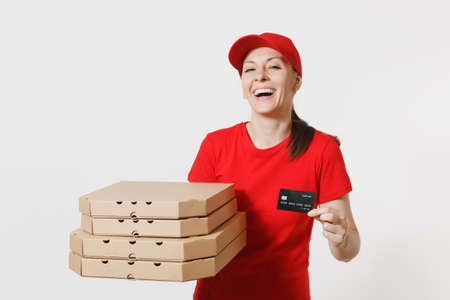 Delivery woman in red cap, t-shirt giving food order italian pizza in cardboard flatbox boxes isolated on white background. Female pizzaman working as courier holding credit card. Service concept