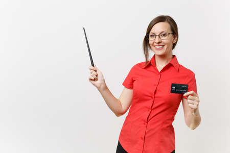 Portrait of young business teacher woman in red shirt, glasses holding cedit bank card, woodenpointer on copy space isolated on white background. Education teaching in high school university concept Standard-Bild - 106214456