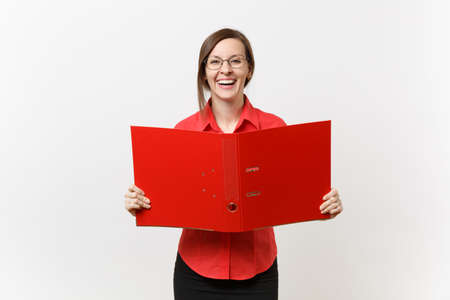 Portrait of young successful business teacher woman in red shirt, glasses holding folder with paper work documents isolated on white background. Education teaching in high school university concept