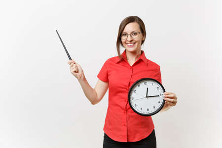Young smart business teacher woman in red shirt glasses holding round clock, wooden classroom pointer on copy space isolated on white background. Education teaching in high school university concept Banque d'images - 106206999