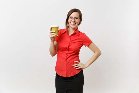Portrait of happy smiling young business teacher woman in red shirt glasses holding cup of coffee or tea in hands isolated on white background. Education or teaching in high school university concept Stock Photo