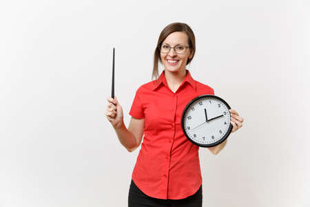 Young smart business teacher woman in red shirt glasses holding round clock, wooden classroom pointer on copy space isolated on white background. Education teaching in high school university concept Banque d'images - 107057968