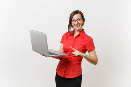 Portrait of beautiful young business teacher woman user in red shirt glasses working typing on laptop pc computer isolated on white background. Education or teaching in high school university concept Stock Photo