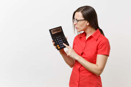 Portrait of business teacher or accountant woman in red shirt, glasses holding calculator in hands isolated on white background. Education teaching in high school university, accounting count concept