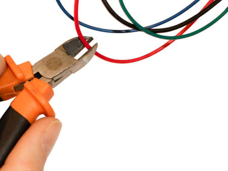Cutting red wire by wire cutters. Safety precautions, bomb neutralization