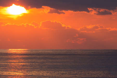 specular: Magnificent sunset on the ocean, warm waves and sunshine