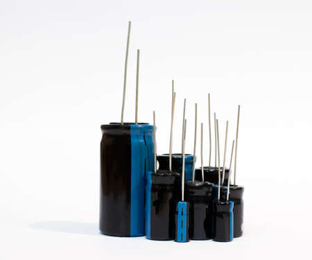 electrolytic: Electronic components - a set of electrolytic capacitors on white background Stock Photo