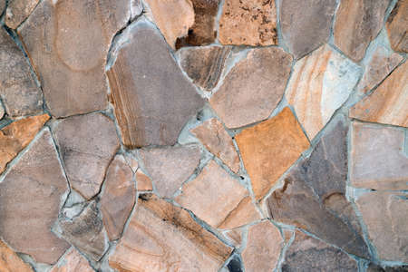 Natural building material, multi-colored sandstone wall texture background patterns Stock Photo