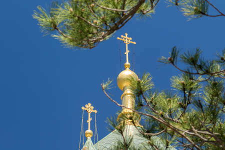 The golden dome and crosses of the Orthodox Church of the Holy Resurrection of Christ in Yalta near the place Baydarskie Gates, Crimea