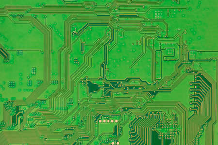 Circuit board, modern electronics backside green color background closeup Stock Photo