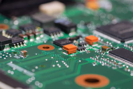 Laptop motherboard closeup. Printed circuit Board with SMD capacitors, resistors, diodes and chips. Stock Photo